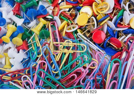 Close up of colorful pushpin and paper clips
