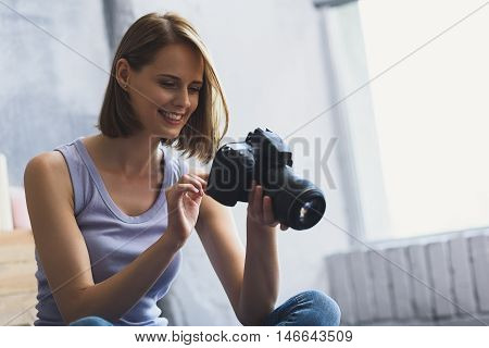 it looks great, young woman enjoying photo she made