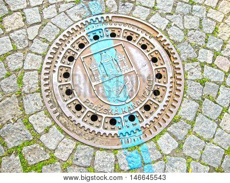 Manhole on old style brick road in Prague Czech Republic