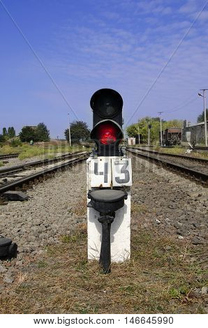 Traffic light shows red signal on railway