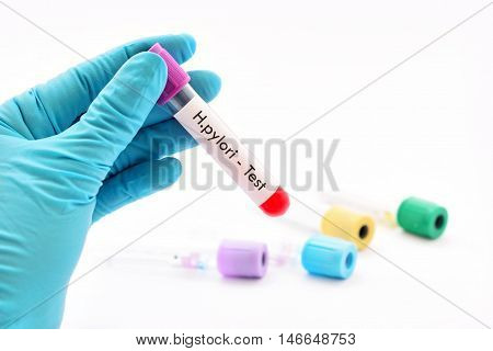 Test tube with blood sample for H.pylori bacteria test