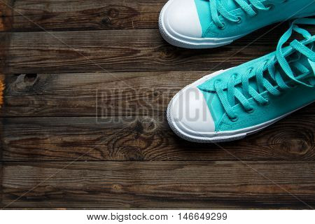 blue shoes on wooden floor