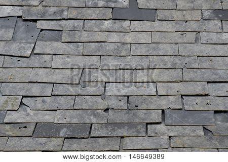 Esteville France - june 23 2016 : damaged slate roof