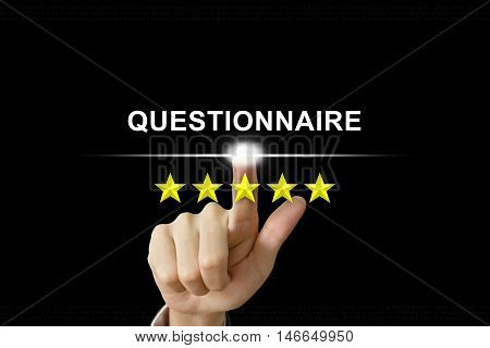 business hand clicking questionnaire with five stars on screen