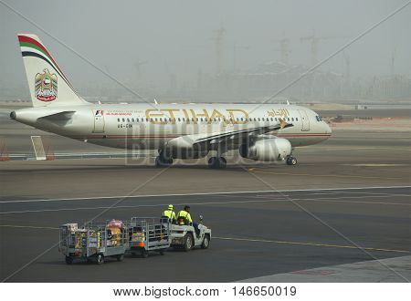 ABU DHABI, UAE - MARCH 10, 2015: The Airbus A318-321 ( A6-EIM) before departure. The Abu Dhabi Airport