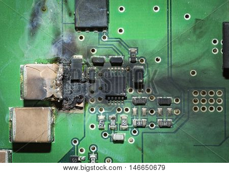burned electronic SMD printed circuit board PCB after a short circuit