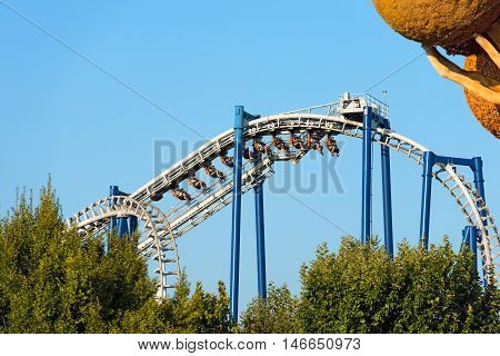 CASTELNUOVO DEL GARDA VERONA ITALY - AUGUST 28 2016: The Blue Tornado a roller coaster (inverted coaster) in the famous theme park of Gardaland in Castelnuovo del Garda Verona Italy