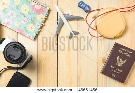Travel blogger equipments on wooden table with copy space.
