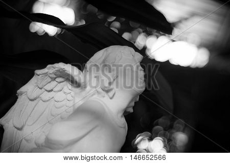 Statue of a beautiful child in black and white color. Little angle statue in black and white color.