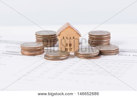 House and coins stack realestate concept, business