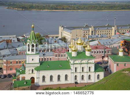 The old Church of the Nativity of John the Baptist on the background of the Volga river. Nizhny Novgorod, Russia