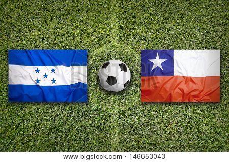 Honduras Vs. Chile Flags On Soccer Field, 3D Illustration