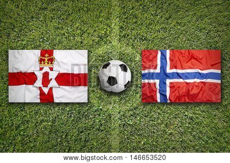 Northern Ireland Vs. Norway Flags On Soccer Field, 3D Illustration