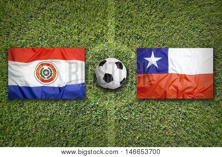 Paraguay Vs. Chile Flags On Soccer Field, 3D Illustration