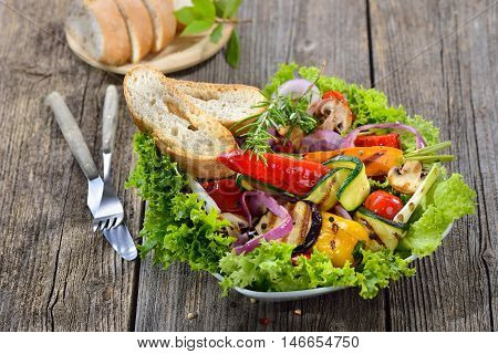 Mixed grilled vegetables on lollo bionda salad served with toasted Italian ciabatta bread