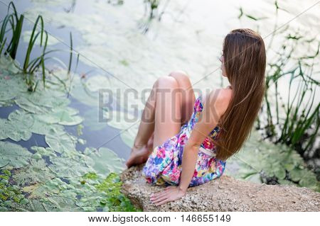 back woman legs in the lake water