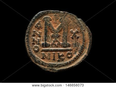 Ancient Copper Byzantine Coin In Red Patina