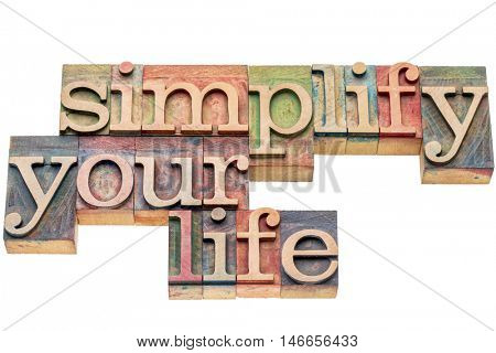 simplify your life advice -  isolated word abstract in letterpress wood type