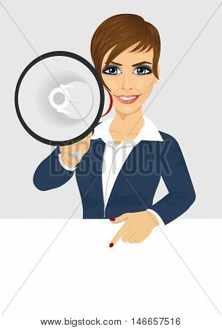 businesswoman shouting with megaphone pointing to billboard with text for copyspace. Business concept