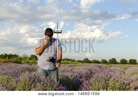 Lavender field and surveyor in horizontal shot
