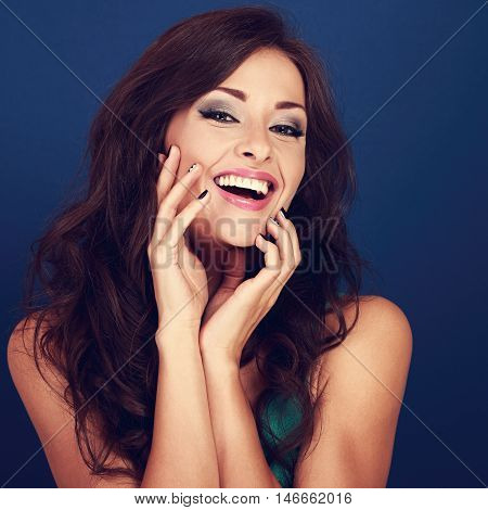 Laughing Beautiful Curly Hair Style Woman Touching Manicured Fingers The Face On Bright Blue Backgro