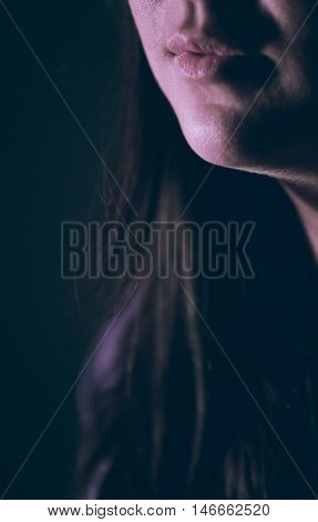 Closeup of woman mouth on a black background. FIlm scan