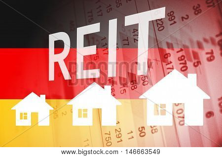 Inscription REIT and house icons on PC screen. Positive Trend in Germany Property Market.