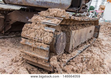 Dirty foot of tractor in construction plant