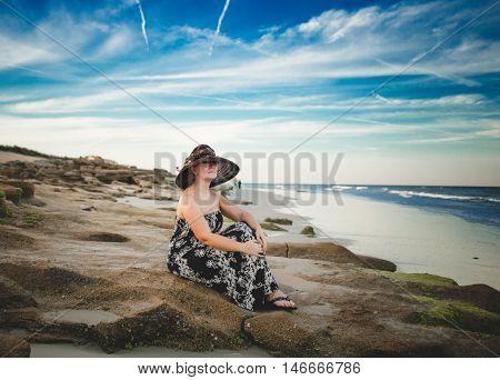 Girl walking on the beach near the ocean