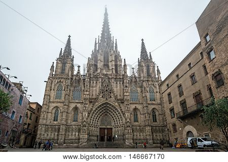 Barcelona Cathedral in foggy rainy morning in Gothic Quarter