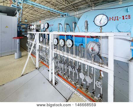 The control panel oil pressure measurement in steam turbine units. Turbine room nuclear power plant. The old authentic gauges.