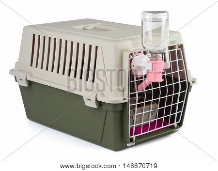 Pet carrier with feeding and watering supply for long transportation isolated on white