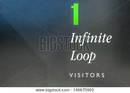 Cupertino, CA, USA - August 15, 2016: close up of Apple One Infinite Loop sign at Apple Inc HQ located in Cupertino, Silicon Valley, California. Apple is an American multinational technology company.