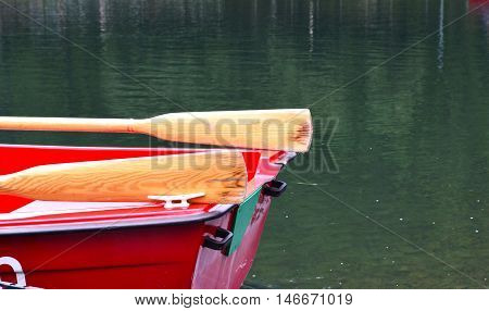 Wooden rescue boat on the lake. Red boat.