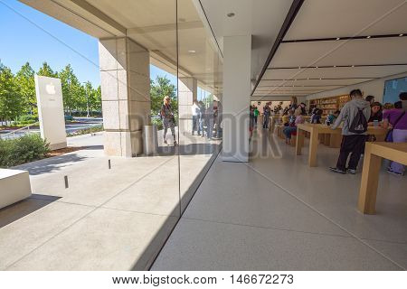 Cupertino, CA, USA - August 15, 2016: people inside the popular Apple store of Apple Inc Headquarters at One Infinite Loop located in Cupertino, Silicon Valley, California.