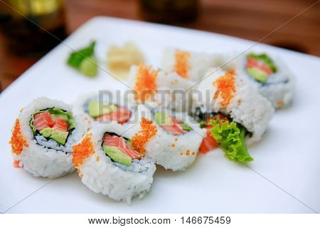 Rolls With Salmon, Avocado And Caviar Over White Background
