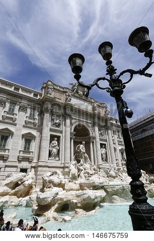 Rome Italy: The Trevi Fountain Italian: Fontana di Trevi. It is designed by Italian architect Nicola Salvi and completed by Pietro Bracci. The largest baroque fountain in the city.