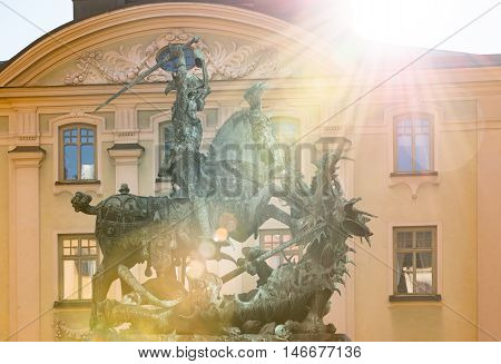 Statue of St. George and Dragon in old town of Stockholm Gamla Stan. Sun beaming in camera. Sweden Scandinavia Europe.
