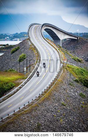 Two bikers on motorcycles. Atlantic Ocean Road or the Atlantic Road (Atlanterhavsveien) been awarded the title as