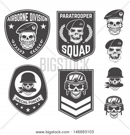 Set of military emblems and design elements. Skulls with military headdresses. paratrooper. Airborne division. Design elements for emblem badge label.