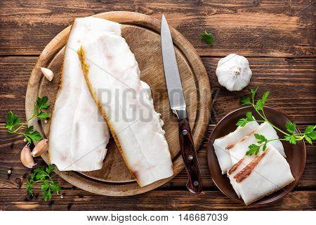 fresh pork fat lard on wooden table