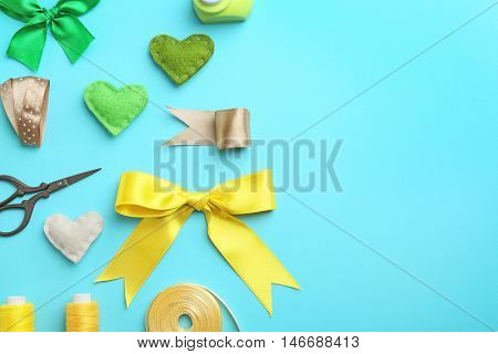 Handcraft flat lay in green and yellow colour on turquoise background
