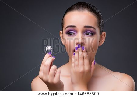 Young woman with diamond ring proposal for marriage
