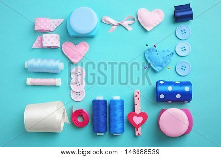 Flat lay of handcraft on blue background