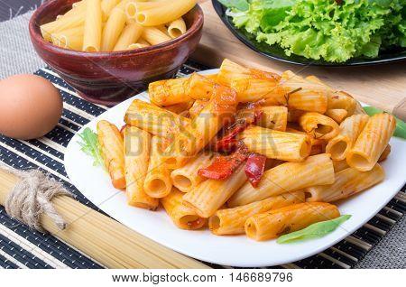 Cooked Rigatoni Pasta, Seasoned With Pepper And Arugula