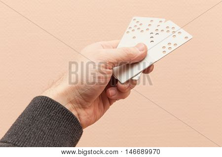 Male Hand Holds Two Hotel Door Key Cards