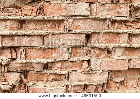 Texture of the old walls of the crumbling brick red color