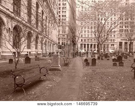 This is a photograph of a grave yard in the heart of low Manhattan, the picture was taken in December 2015