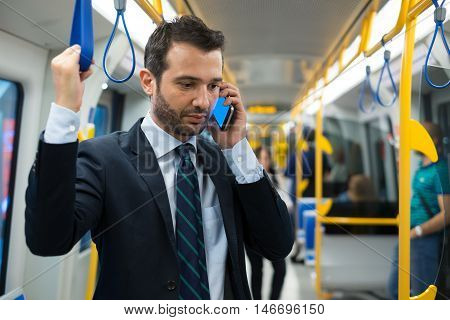 Businessman Commuter Traveling On The Metro Underground