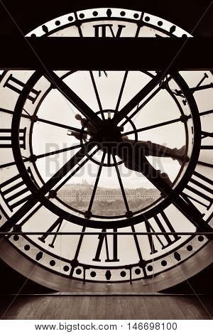 City view through Giant clock tower in Paris, France.